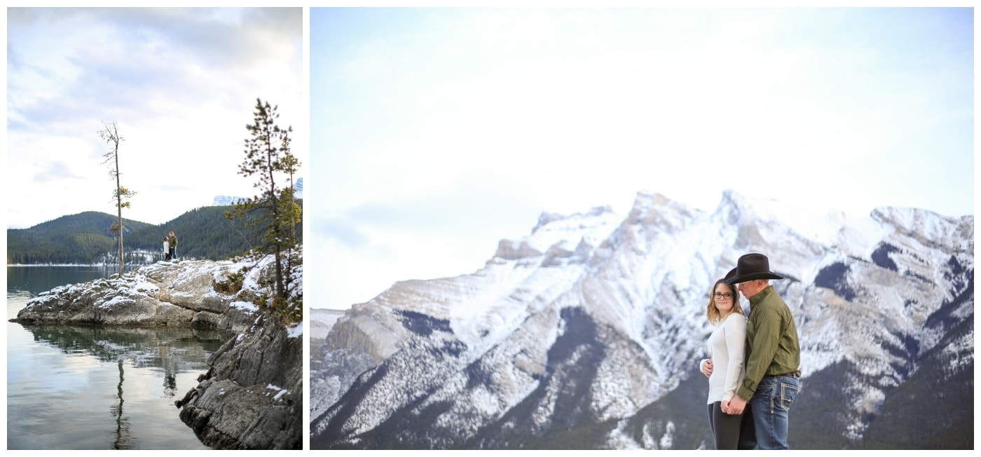 An engagement session in Banff with the couple posing next to Lake Minnewanka with mountains in the background