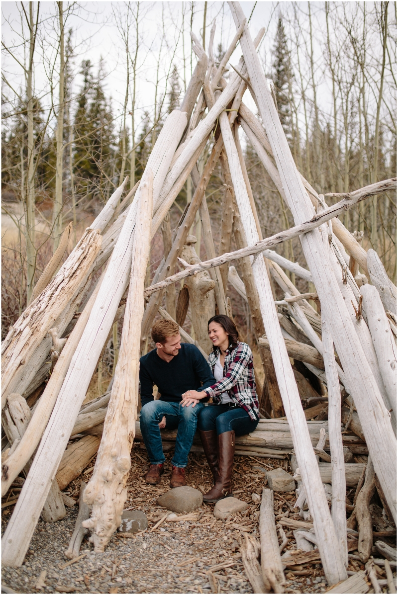 A beautiful adventure engagement session in the Rocky Mountains of Alberta at Barrier Lake, Kananaksis, and Spray Lakes with 360 mountain views and snow